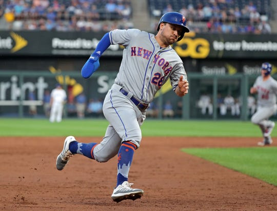 Aug 16, 2019; Kansas City, MO, USA; New York Mets left fielder J.D. Davis (28) rounds third base during the third inning against the Kansas City Royals at Kauffman Stadium.