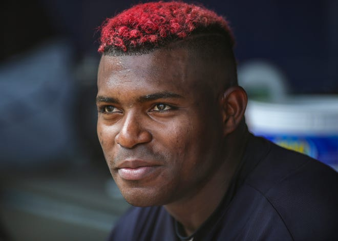 Aug 17, 2019; Bronx, NY, USA; Cleveland Indians right fielder Yasiel Puig (66) in the dugout in the fourth inning against the New York Yankees at Yankee Stadium.