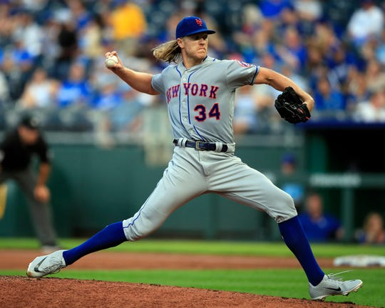 New York Mets starting pitcher Noah Syndergaard delivers to a Kansas City Royals batter during the first inning of a game at Kauffman Stadium in Kansas City, Mo., Friday, Aug. 16, 2019.