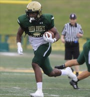 St. Joseph running back Audric Estime  runs against Pope John who came to play St. Joseph in Montvale for a high school football pre season scrimmage on August 17, 2019.