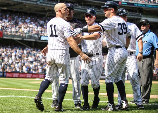 Aug 17, 2019; Bronx, NY, USA; New York Yankees center fielder Brett Gardner (11) is restrained after being ejected in the sixth inning against the Cleveland Indians at Yankee Stadium.