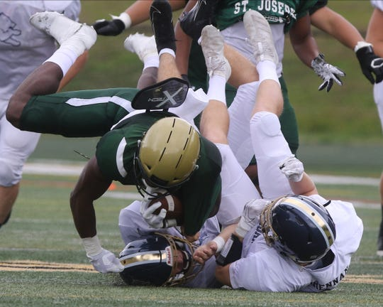 St. Joseph running back Audric Estime is tackled as he runs against Pope John who came to play St. Joseph in Montvale for a high school football pre season scrimmage on August 17, 2019.