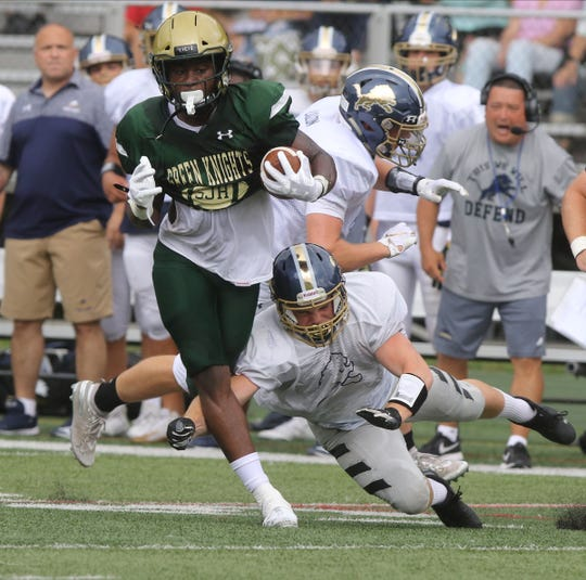 St. Joseph running back Audric Estime breaks a tackle as he runs against Pope John who came to play St. Joseph in Montvale for a high school football pre season scrimmage on August 17, 2019.