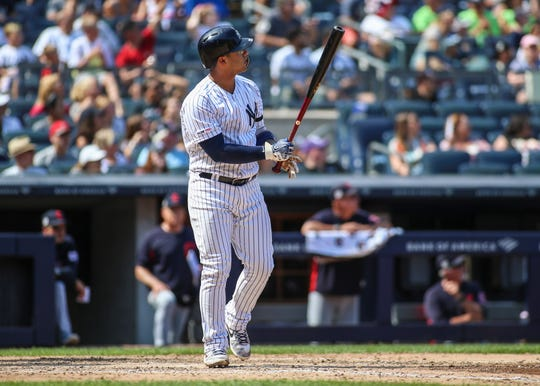 Aug 17, 2019; Bronx, NY, USA; New York Yankees shortstop Gleyber Torres (25) hits his second home run of the game in the sixth inning against the Cleveland Indians at Yankee Stadium
