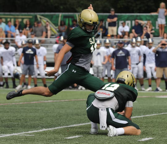 St. Joseph kicker Sebastian Tasko kicking one of extra points against Pope John who came to play St. Joseph in Montvale for a high school football pre season scrimmage on August 17, 2019.
