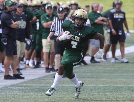 St. Joseph running back Andre Epps runs the ball to the end zone for a touchdown against Pope John who came to play St. Joseph in Montvale for a high school football pre season scrimmage on August 17, 2019.