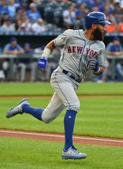 Amed Rosario #1 of the New York Mets runs to first after hitting a single in the first inning against the Kansas City Royals at Kauffman Stadium on August 16, 2019 in Kansas City, Missouri.