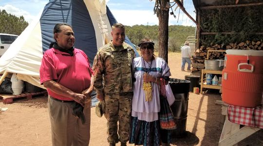 Col. Chris Ward, center, with Mescalero Apache medicine man Freddie Kaydahzinne and medicine woman Karen Geronimo.