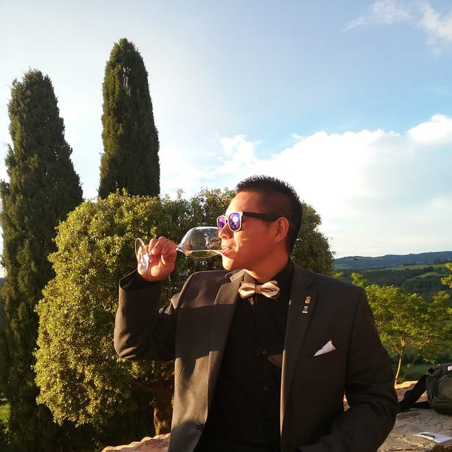 Cordell Pacheco, a New Mexico State University student in the School of Hotel, Restaurant and Tourism Management, samples wine at a gala dinner hosted this summer at the Castello Banfi winery in Montalcino, Italy.