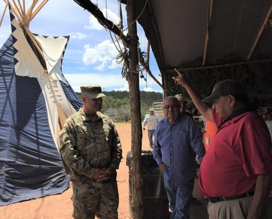 Col. Chris Ward, left, listens as medicine man Freddie Kaydahzinne shares the history and culture of the Mescalero Apache during the Oscura Blessing Ceremony at White Sands Missile Range. Also pictured is Simon Simms.