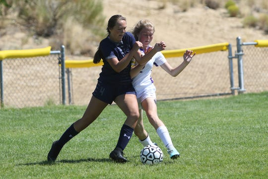 Elizabeth Gephardt of Piedra Vista and Abby Warner of Kirtland Central battle for possession of the ball during Saturday's 2019 season opener at PVHS.