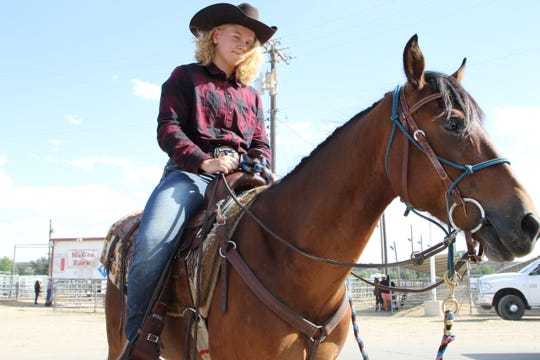 "Jaiden Williams of Bloomfield and ""Prancer"" get ready for Friday's Wild Horse Challenge at McGee Park in Farmington."