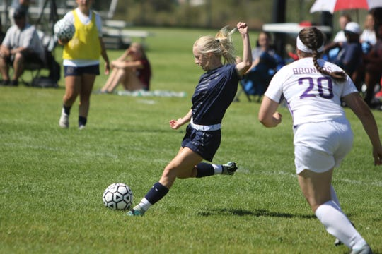 Lauren Jaqua of Piedra Vista passes the ball down the right side against Kirtland Central during Saturday's 2019 season opener at PVHS.