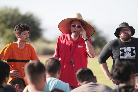 Desert Mirage High School football head coach Gustavo Sandoval, center, talks to the players at the school in Thermal, Calif., on Friday, August 16, 2019.