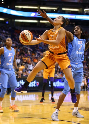 Phoenix Mercury guard Leilani Mitchell drives to the basket and scores past against Atlanta Dream forward Jessica Breland in the first half on Aug. 16, 2019 in Phoenix, Ariz.