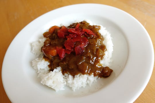 Zeppin, a brand of Japanese curry roux, prepared and served over rice with fukujinzuke.