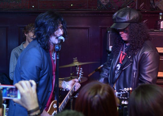 Gilby Clarke (L) and Slash perform onstage during the BandFuse: Rock Legends video game launch event at House of Blues Sunset Strip on November 12, 2013 in West Hollywood.
