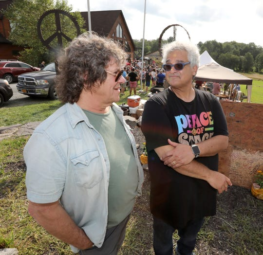 Original Woodstock promoter Michael Lang and Steve Gold of Peace of Stage at the Catskill Distillery/Dancing Cat Saloon in Bethel Aug. 17, 2019. Lang was there to sign a gun control petition on a piece of the original Woodstock stage.