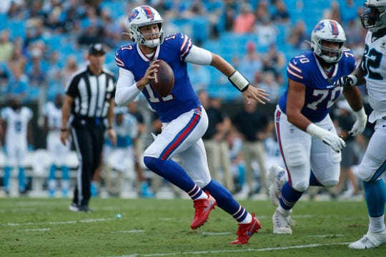 Buffalo Bills quarterback Josh Allen (17) runs out of the pocket during the first half an NFL preseason football game against the Carolina Panthers, Friday, Aug. 16, 2019, in Charlotte, N.C. (AP Photo/Brian Blanco)