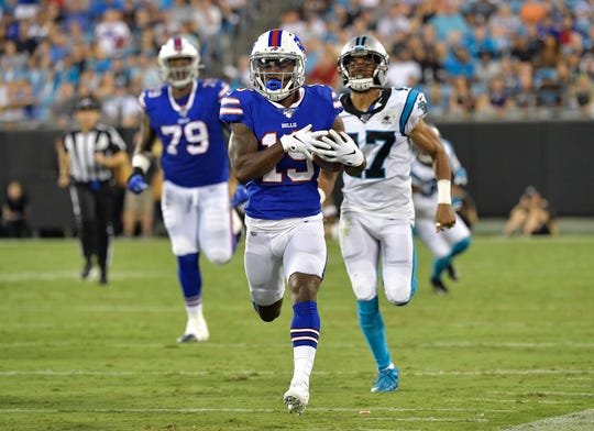 CHARLOTTE, NORTH CAROLINA - AUGUST 16: Isaiah McKenzie #19 of the Buffalo Bills breaks away from Ross Cockrell #47 of the Carolina Panthers during the second quarter of their preseason game at Bank of America Stadium on August 16, 2019 in Charlotte, North Carolina. (Photo by Grant Halverson/Getty Images)