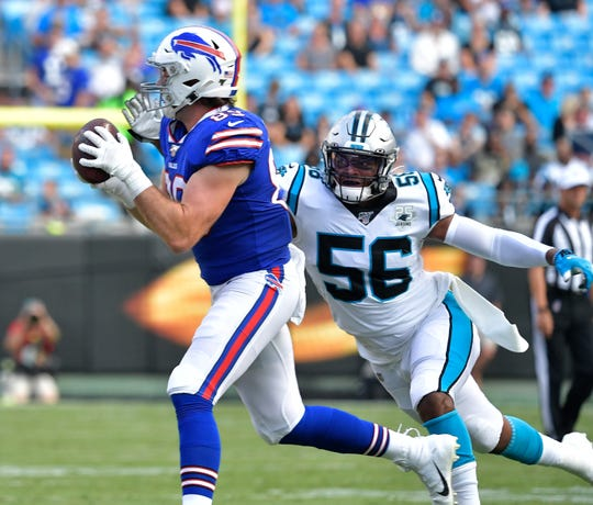 CHARLOTTE, NORTH CAROLINA - AUGUST 16: Tommy Sweeney #89 of the Buffalo Bills makes a catch against Jermaine Carter #56 of the Carolina Panthers during the first quarter of their preseason game at Bank of America Stadium on August 16, 2019 in Charlotte, North Carolina. (Photo by Grant Halverson/Getty Images)