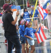Despite heavy rain those that showed up early Saturday afternoon at the 50th Puerto Rican Festival made the best and enjoyed themselves at Frontier Field.