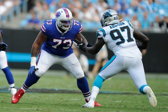 Buffalo Bills offensive tackle Dion Dawkins (73) works against Carolina Panthers defensive end Mario Addison (97) during the first half an NFL preseason football game, Friday, Aug. 16, 2019, in Charlotte, N.C. (AP Photo/Mike McCarn)