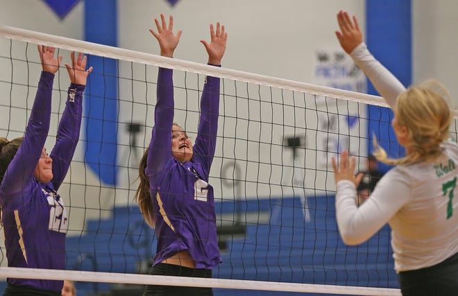 Sterling City High School's Kiely Johnson (2) and Peighton Glass (22) go up for a block against Wall during the 2019 Nita Vannoy Memorial Volleyball Tournament on Friday, August 16, 2019.