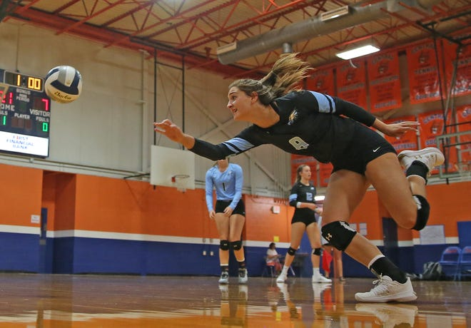 TLCA's Kait Kirkland chases a ball during the 2019 Nita Vannoy Memorial Volleyball Tournament on Friday, August 16, 2019.