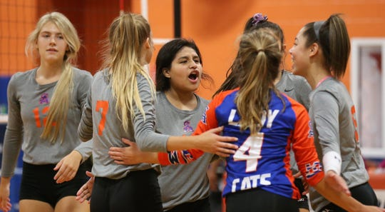 The San Angelo Central High School volleyball team celebrates during a 25-15, 25-1 win against El Paso Irvin on Day 1 of the Nita Vannoy Tournament at Central's Trevino gym on Friday, Aug. 16, 2019.