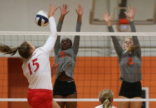 Miles High School's Regan Smithwick (15) goes up for an attack against San Angelo Central's Kameryn Daniels (9) and Presley Knowlton (12) during the 2019 Nita Vannoy Memorial Volleyball Tournament on Friday, August 16, 2019.