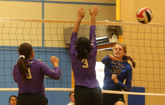 Veribest High School's Bella Halfmann (20) hits the ball past Pecos' Aubrie Navarette, left, and Jocelyn Garcia (3) in the 2019 Nita Vannoy Memorial Volleyball Tournament on Friday, August 16, 2019.