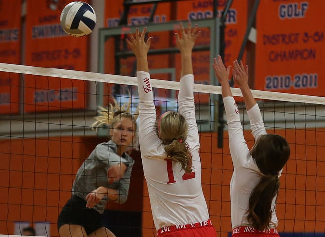San Angelo Central High School's Steely Poss (in gray) spikes the ball as Miles' Kinsley Riddle (12) and Libby Crouch defend the net  during the Nita Vannoy Memorial Volleyball Tournament Friday, Aug. 16, 2019.