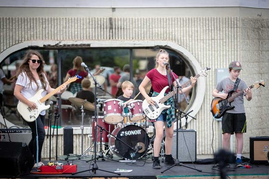 The Hunt, featuring Carrie Schneider and siblings Sam, Gabe and Lucy Lunser, perform at the 2018 Common Roots Festival's student showcase.