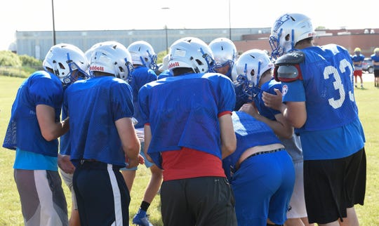 The Foley Falcons huddle up Thursday, Aug. 15, 2019. Foley is coming off of a 3-6 season in 2018.