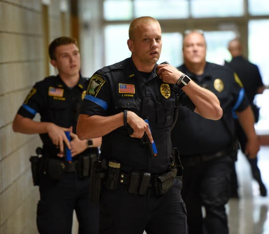 Sauk Rapids police officer Charles Swiggum speaks into his radio Wednesday, Aug. 14, 2019, at Sauk Rapids-Rice Middle School. Local law enforcement and fire departments practiced responding to active threat situations in schools.