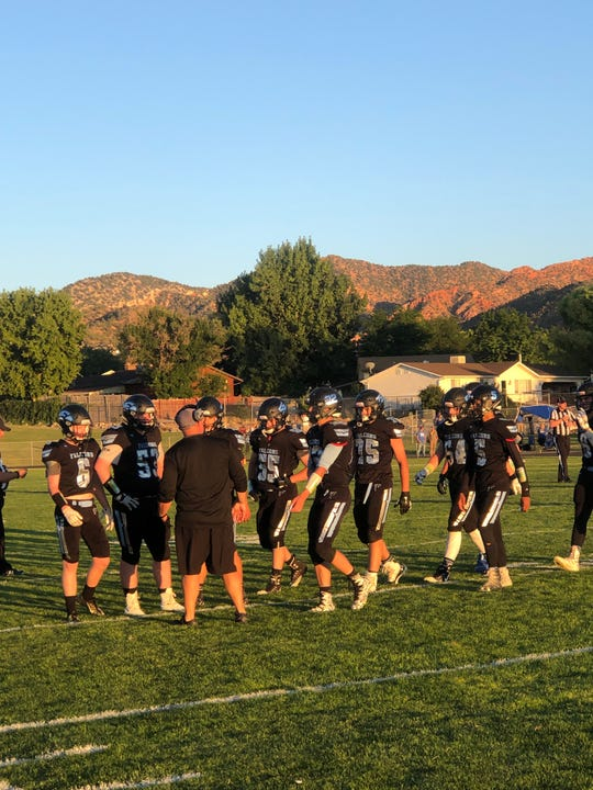 Canyon View head coach Chris Sawyers talks to his players during a timeout in a game against Beaver on Aug. 16, 2019.