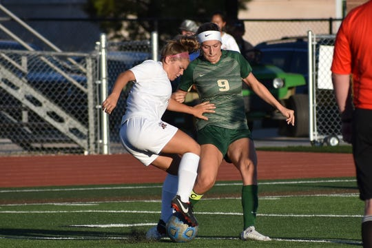 Snow Canyon's Rachel Durante (9) fights for possession against a Mountain View player on Thursday, August 15.