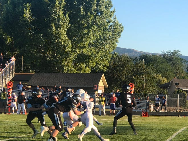 Canyon View QB Brisin Jake drops back to pass during the Falcons' 60-7 loss to Beaver on Aug. 16, 2019.