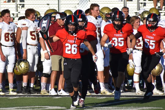 Hurricane's Connor Nielsen leads the Tigers onto the field before their game against Juab on August 16, 2019.