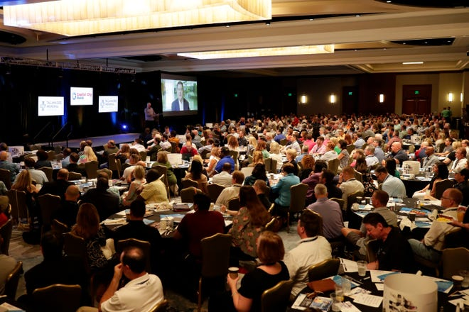 Local business leaders and politicians attend the opening session for the Tallahassee Chamber Conference in Amelia Island, Fla., Saturday, Aug. 17, 2019.