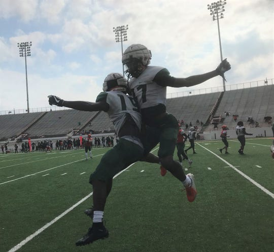 FAMU wide receiver Andrew Davis (right) celebrates his touchdown catch with Xavier Smith during a scrimmage on Saturday, Aug. 17, 2019.