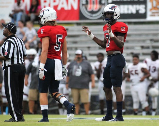 Wakulla four-star linebacker Keyshawn Greene, an FSU commit, gets sideline directions as Madison County traveled to Wakulla and won 27-26 during a preseason game on Aug. 16, 2019.