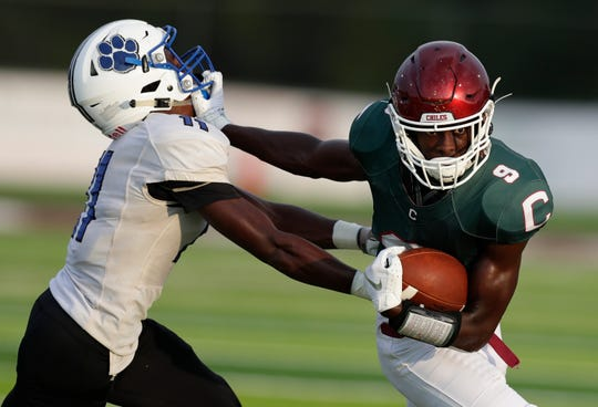 Chiles junior Jalen Herring stiff arms during a run as the Timberwolves hosted Godby for a preseason game at Chiles High School Friday, August 16, 2019.