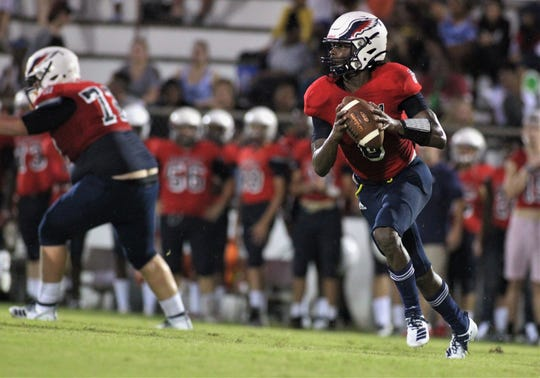 Wakulla quarterback Jaylon Worsham rolls out as Madison County traveled to Wakulla and won 27-26 during a preseason game on Aug. 16, 2019.