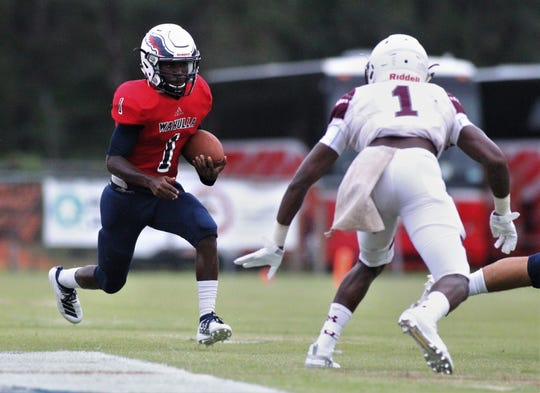 Wakulla running back Jakari Ervin looks for running room as Madison County traveled to Wakulla and won 27-26 during a preseason game on Aug. 16, 2019.
