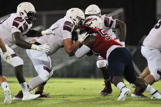 Madison County senior offensive lineman Zane Herring, an FSU commit, blocks as Madison County traveled to Wakulla and won 27-26 during a preseason game on Aug. 16, 2019.