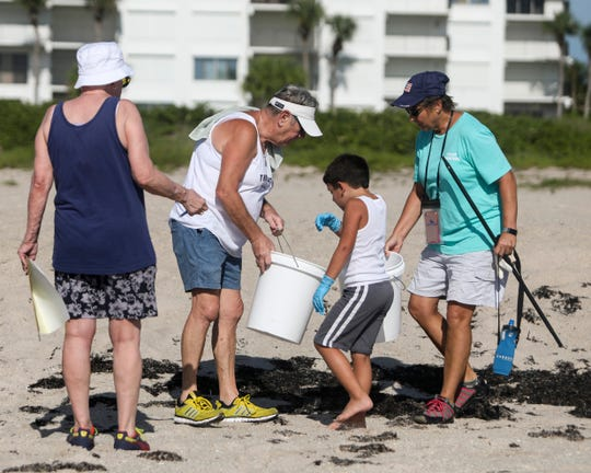 "Volunteers collect trash during the third coastal cleanup of the year hosted by Coastal Connections at South Beach Park on Saturday, August 17, 2019, in Vero Beach. One of Coastal Connections initiatives this year is plastic reduction and part of their effort is going towards coastal cleanups. ""We just want to do our part by removing plastics and debris so we can continue to enjoy the beautiful space,"" said Kendra Cope, president of Coastal Connections."