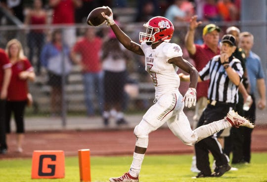 Vero Beach's Jermaine Dawson runs the ball in for a touchdown during the second quarter against Sebastian River during the high school football Kickoff Classic game Friday, Aug. 16, 2019, at Sebastian River High School. Dawson and his quarterback, Ryan Jankowski, were named to the FloridaHSFootball all-state first team.