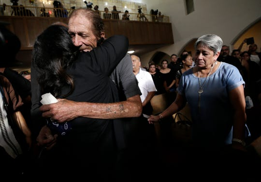 Antonio Basco gets hugs from thousands of El Pasoans who showed up to his wife Margie Reckard's prayer service Friday, Aug. 16, 2019, at La Paz Faith Center in El Paso, Texas. His wife was one of the 22 people killed in the Walmart mass shooting on Aug. 3, 2019.
